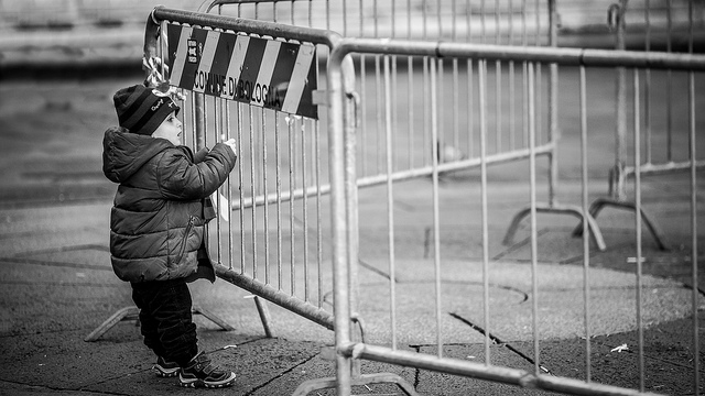 child standing at fence