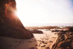 Sunshine and rocks on beach